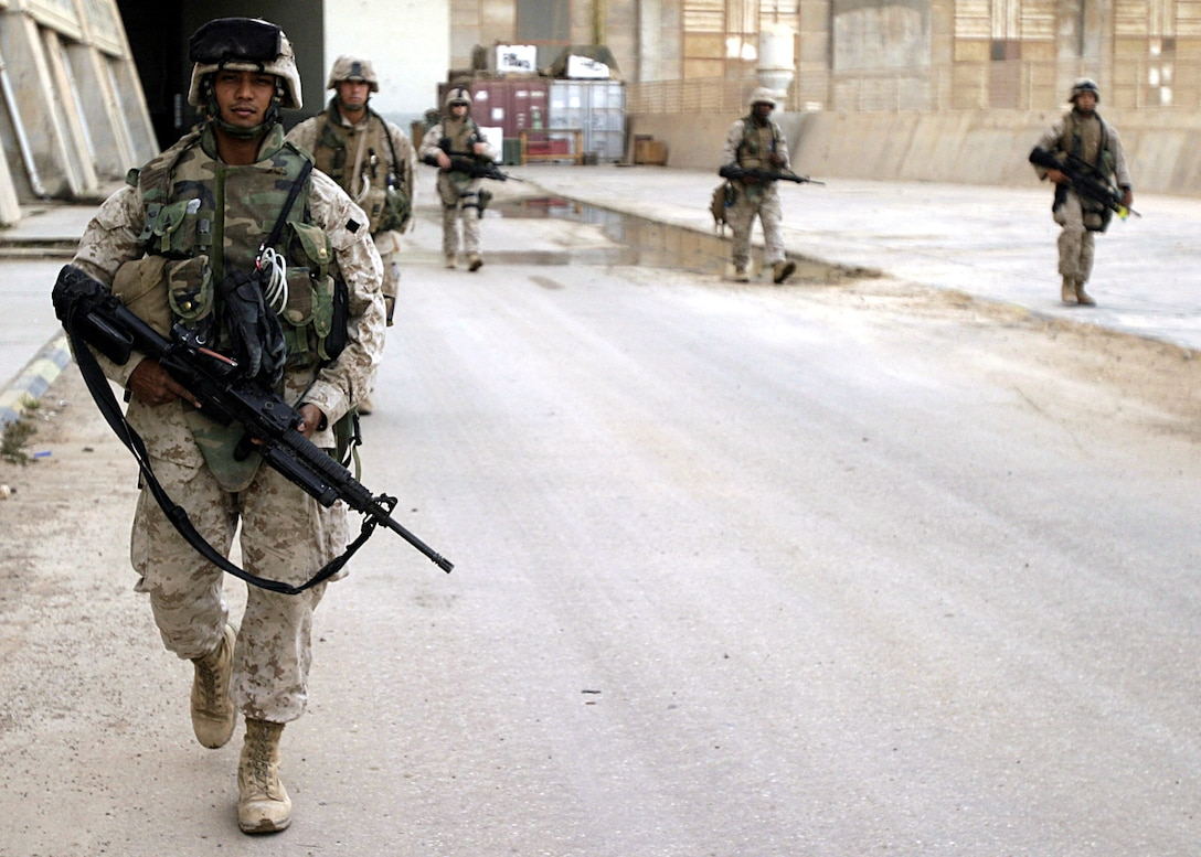 Haditha Dam, Al Anbar, Iraq (July 14, 2005)--Cpl. Mohammed N. Rahman, a infantryman with 2nd platoon, Lima Co., 3rd Battalion, 25th Marines prepares to go on a patrol with his squad here. (Official USMC Photo by Corporal Ken Melton)