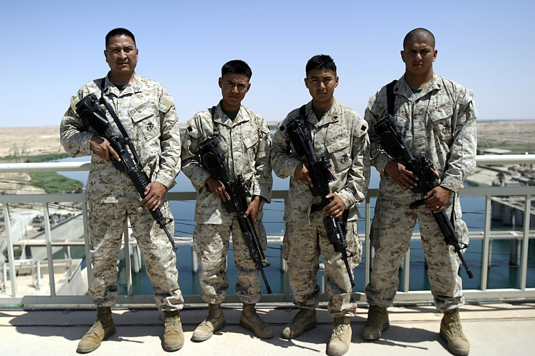 Al Asad, Al Anbar, Iraq  - Civil Affairs SNCOIC, Master Sgt. Steve Jakes, 46 of Tohlaki, N.M., Infantrymen Lance Cpl. Cheston E. Bailon,20 of Shiprock, N.M, Sgt. Leighton Redhouse, 25 of Upper Fruitland, N.M., Sgt. Jonathon D. Mc Kenzie, 27 of Shiprock, N.M., are all members of the Navajo Nation who are proudly serving thier country in Iraq with 3rd Battalion, 25th Marine Regiment.