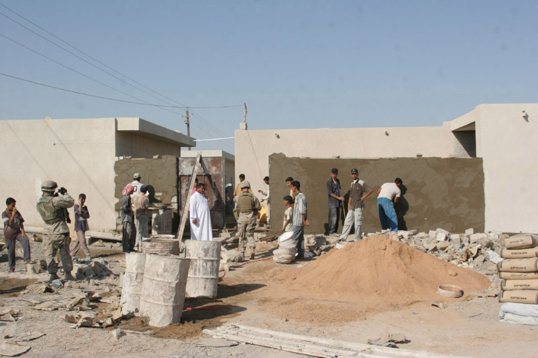050929-M-2607O-001 AL ANBAR PROVIENCE, Iraq -- Local contractors work on a primary school in 2d Battalion, 2d Marine Regiment's, Area of Operation which one of the 6th Civil Affairs Group four school projects that are now all finished.  The local children will attend daily classes in their new school once all the supplies are in the classrooms.