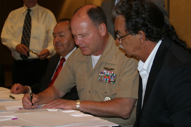 Cpl. Micah Snead Colonel Harmon Stockwell, the commanding officer of Marine Corps Air Station Beaufort, signs a memorandum of understanding with Kenneth Edward Chambers, the principal chief of the Seminole Nation, in Tulsa, Okla., July 8.