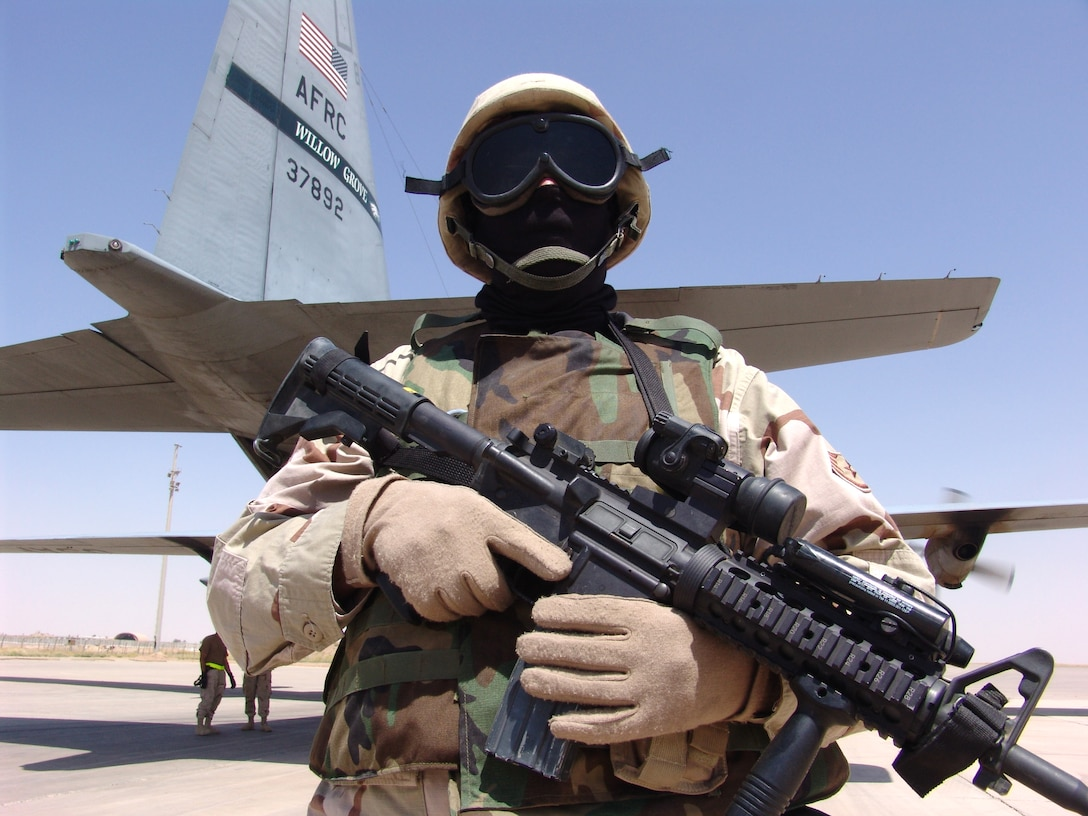 SOUTHWEST ASIA -- Staff Sgt. Leslie Poling guards a C-130 Hercules and crew after arriving at Kirkuk Air Base, Iraq. Security Forces' Ravens are flyaway security forces teams that protect aircraft and aircrews while airborne and on the ground.  Sergeant Poling is assigned to the 386th Expeditionary Security Forces Squadron and is deployed from Royal Air Force Lakenheath, England.  (U.S. Air Force photo by Master Sgt. Al Gerloff)