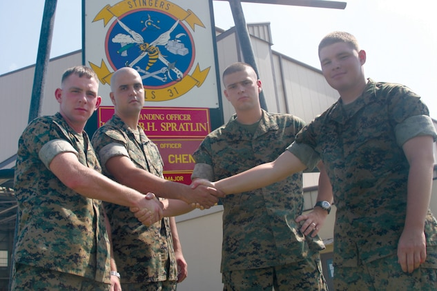 Cpl. K.A. Thompson From left to right Marine Aviation Logistics Squadron 31 avionics technicians Cpl. Kevin Boody and Lance Cpls. Jared Knight, Guy Jerez and Richard Kinmartin are always ready to lend a helping hand. Sgt. Ruben Trujillo and Lance Cpl. Adam Hunter, the other Marines recognized, are currently deployed. Main Street Beaufort USA awarded certificates of appreciation to the Marines for their volunteer work at the annual Taste of Beaufort Festival in May. The Marines received their certificates at a ceremony held at the Beaufort Arsenal on July 13. During the ceremony Lt. Col. Blayne Spratlin, the MALS-31 commanding officer, also accepted the Outstanding Volunteer of the Year Award for Excellence, on behalf of MALS-31 and Marine Aircraft Group 31.   050724-M-0575T-003