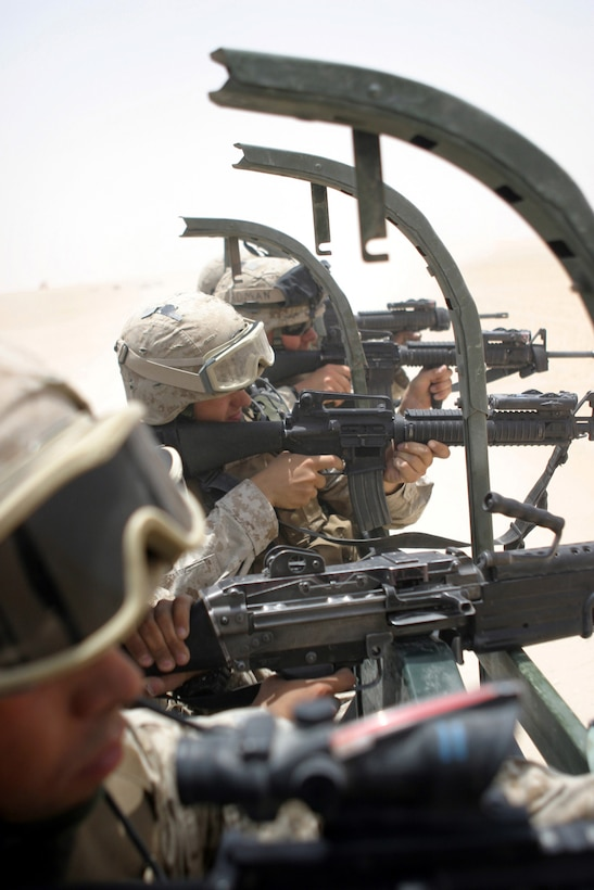 Marines of 2nd platoon, Gulf Company, Battalion Landing Team, 2nd Bn., 8th Marines, 26th Marine Expeditionary Unit (Special Operations Capable), fire M16-A2 service rifles during a convoy live fire exercise June 3 at Udairi Range, Camp Buehring, Kuwait.  As the theatre reserve, for Central Command, Marines of the 26th MEU (SOC) are conducting live fire exercises at Udairi Range, near Camp Buehring, Kuwait in preparation for potential follow-on missions in the region. (USMC photo by LCpl. Daniel R. Lowndes) (Released)