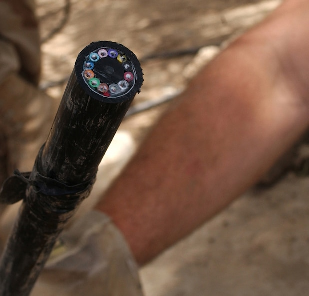 BAGHDAD, Iraq -- More than 22 miles of 144-strand fiber optic cable will be installed here to provide state-of-the-art communication among coalition compounds.  Each fiber optic strand is made of optically pure glass and is thinner than a human hair.  (U.S. Air Force photo by Tech. Sgt. Brian Davidson)