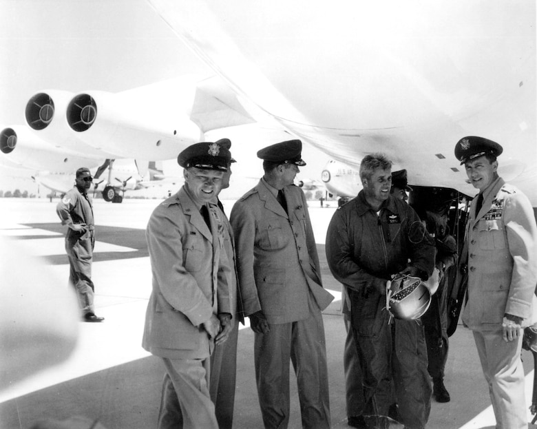 CASTLE AIR FORCE BASE, Calif. -- Retired Brig. Gen. William Eubank, the 93rd Bomb Wing commander, talks with Air Force officers on the flightline here after the first B-52 Stratofortress operational flight June 29, 1955.  (U.S. Air Force photo)