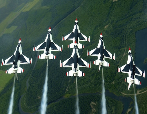 EIELSON AIR FORCE BASE, Alaska -- The Thunderbirds aerial demonstration team performs a loop while in the famous Delta formation here. The Thunderbirds fly the F-16 Fighting Falcon, a fighter that is highly maneuverable and has a proven record in combat. (U.S. Air Force photo by Tech. Sgt. Sean M. White)