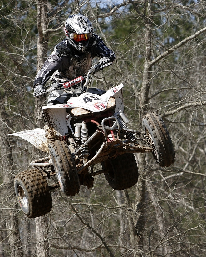 A quad rider catches some air during the Motocross spring series opener at Half Moon MX Park in Jacksonville, N.C. Many Marines with the II Marine Expeditionary Force headed out to the tracks to compete in the races. Motocross offers Marines a safe -and legal- alternative to street racing.