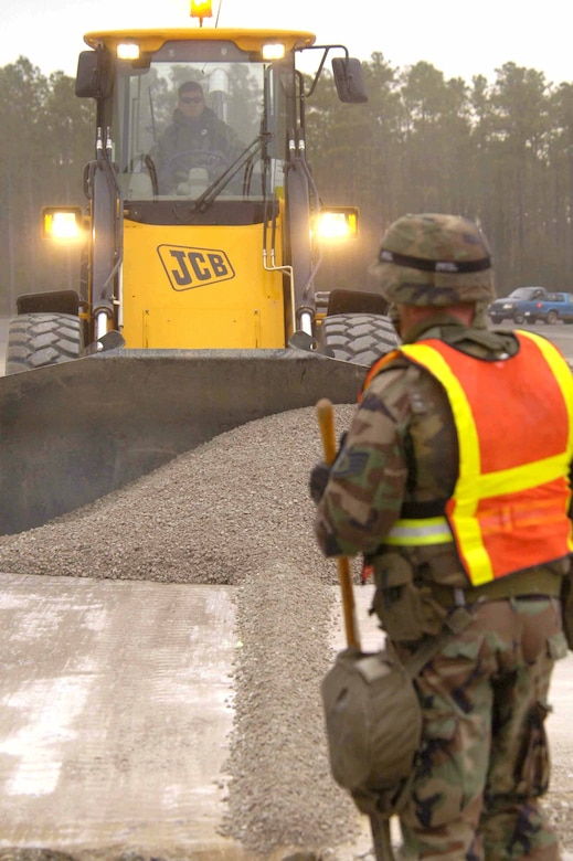 EGLIN AIR FORCE BASE, Fla. -- Staff Sgt. Charles Cahoon guides a front-end loader as it fills a crater.  He is a 796th Civil Engineer Squadron pavement and construction equipment operator.  (U.S. Air Force photo by Michelle Williams)