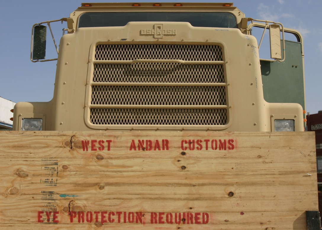 HADITHAH, Al Anbar, Iraq-  This simple board lets Marines with 3/25 know that this where they can get their vehicles  upgraded and customized to military perfection.  (Official USMC Photo by Corporal Ken Melton)
