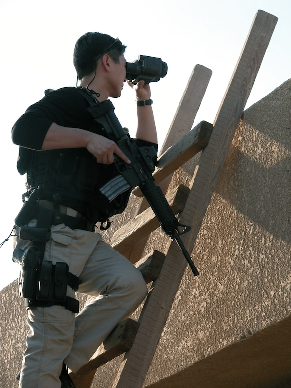 BAGHDAD, Iraq -- A special agent assigned to the Office of Special Investigations Detachment 2408 conducts a counter-surveillance mission near an entry control point here.  OSI agents protect Airmen and Soldiers deployed to Baghdad International Airport from many force-protection threats.  (U.S. Air Force photo)