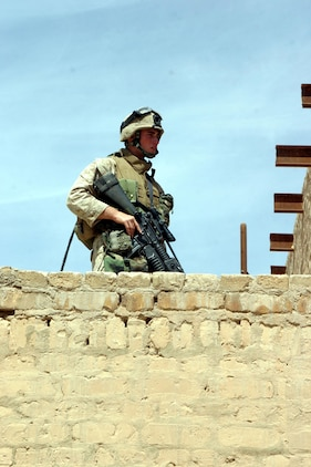 BAGHDAD, Iraq -- (March 30, 2005) - Lance Cpl. Nick J. Cangialosi, 21, an infantry man with A Co., Battalion Landing Team 1/1, and a native of Rochester, N.Y., searches a rooftop for weapons or contraband during a patrol here. BLT 1/1, attached to the 15th Marine Expeditionary Unit (Special Operations Capable), is currently conducting security and stabilization operations in the Greater Baghdad area. (Official USMC photo by Lance Cpl. Thomas J. Grove)