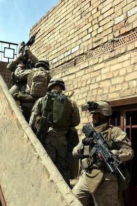 BAGHDAD, Iraq -- (March 30, 2005) - Marines with A Co., Battalion Landing Team 1/1 go up some stairs to search a rooftop during a patrol here. BLT 1/1, attached to the 15th Marine Expeditionary Unit (Special Operations Capable), is currently conducting security and stabilization operations in the Greater Baghdad area. (Official USMC photo by Lance Cpl. Thomas J. Grove)