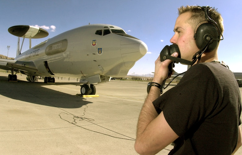 NELLIS AIR FORCE BASE, Nev. -- Staff Sgt. Trevor Wilson prepares an E-3 Sentry Airborne Warning and Control System aircraft for flight during Joint Red Flag 2005 here March 28.  About 10,000 U.S. servicemembers and coalition forces are participating in the exercise here and at Fort Hood, Texas, and Fort Bliss, Texas, until April 2.  Sergeant Wilson is a crew chief with Air Force Reserve Command's 513th Air Control Group from Tinker Air Force Base, Okla.  (U.S. Air Force photo by Tech. Sgt. Patrick M. Kuminecz)