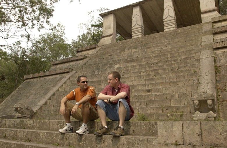 TEGUCIGALPA, Honduras -- Capts. Dan Beard and Cliff Bayne (left to right) chat on the steps of a replica of a Copan Indians temple in United Nations Park, which overlooks the capital city. Both captains are logistics officers for Joint Task Force-Bravo at Soto Cano Air Base, Honduras, and like to visit sites around the country to soak up the local culture and eat the tasty local food. (U.S. Air Force photo by Master Sgt. Lono Kollars)