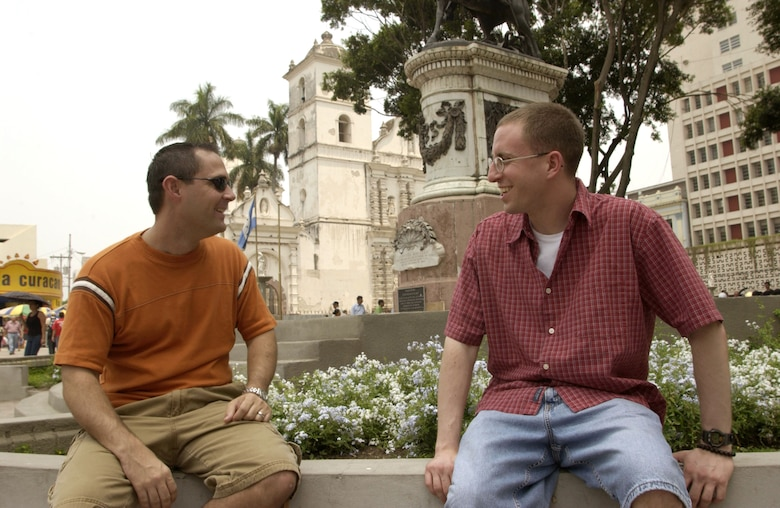 TEGUCIGALPA, Honduras -- Capts. Dan Beard and Cliff Bayne (left to right) take a breather at a monument in the capital city's Plaza Morazan. The two captains are logistics officers with Joint Task Force-Bravo at Soto Cano Air Base, Honduras. When they get a chance, both said they like to explore the country, which gives them a break from life at the austere base. (U.S. Air Force photo by Master Sgt. Lono Kollars)