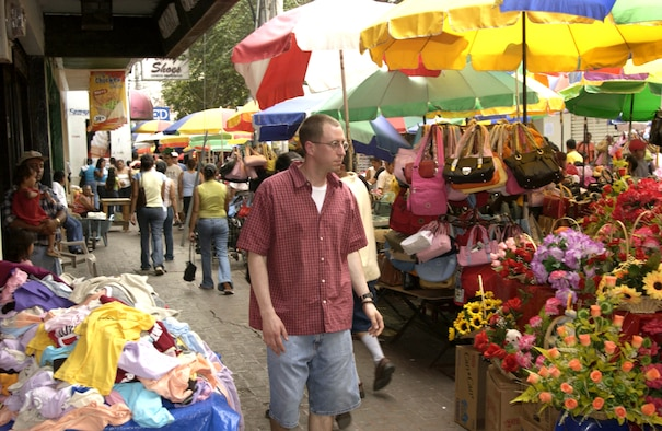 TEGUCIGALPA, Honduras -- Capt. Cliff Bayne looks for souvenirs in a market off Plaza Morazan, the capital city's main plaza. The captain is serving a four-month tour at Soto Cano Air Base, Honduras, where he's a logistics officer for Joint Task Force-Bravo.  (U.S. Air Force photo by Master Sgt. Lono Kollars)