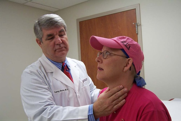 WHITEMAN AIR FORCE BASE, Mo. -- Dr. Larry Geier examines Master Sgt. Dee Ann Poole, who is battling breast cancer.  Sergeant Poole started a cancer support group here and is assigned to the 509th Bomb Wing public affairs office.  (U.S. Air Force photo by Andrea Ernst)