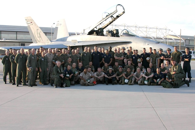 Marine All Weather Fighter Attack Squadron 332 (VMFA(AW)-332) poses for a group photo in front of the jet that flew the unit's 100,000th mishap free hour.  United States Marine Corps Pilots Captain Mark Bortmen and Captain Greg Summa completed a Marine Corps wide record after landing.  VMFA(AW)-332 completed its 100,000th hour of mishap-free flight time that started back in 1978.  Capt. Bortmen and Capt. Summa piloted the 100,000th hour from Marine Corps Air Station Cherry Point, NC, to VMFA(AW)-332's home station, Marine Corps Air Station Beaufort, SC on May 24, 2005. (Official USMC photo by LCpl Brown)(RELEASED)