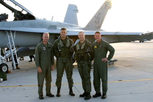 LtCol. David A. Wilbur (left) Commanding Officer of Marine All Weather Fighter Attack Squadron 332 (VMFA(AW)-332) and Colonel Robert S. Walsh (right), Commanding Officer of Marine Aircraft Group 31 (MAG-31) pose with US Marine Corps Pilots Capt. Mark Bortmen (mid-left) and Capt. Greg Summa (mid-right) who completed a Marine Corps wide record after landing.  VMFA(AW)-332 completed its 100,000th hour of mishap-free flight time that started back in 1978.  Capt. Bortmen and Capt. Summa piloted the 100,000th hour from Marine Corps Air Station Cherry Point, NC, to VMFA(AW)-332's home station, Marine Corps Air Station Beaufort, SC on May 24, 2005. (Official USMC photo by LCpl Brown)(RELEASED)