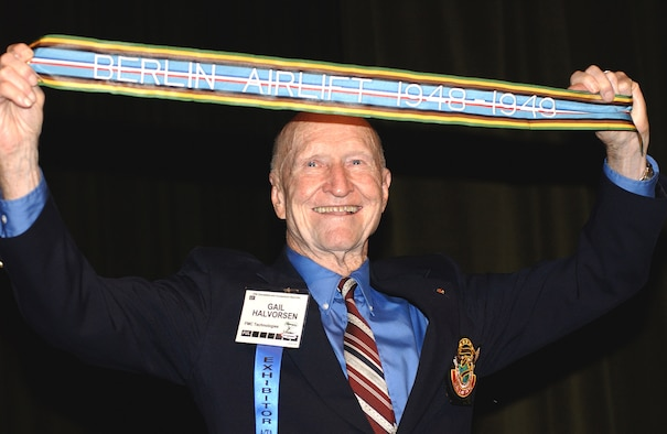 "NASHVILLE, Tenn. -- Retired Col. Gail Halvorsen displays the newly authorized Berlin Airlift streamer presented to him Oct. 29 here at the Airlift Tanker Association convention. Units that  participated in the 1948-1949 humanitarian airlift can include the streamer on their units' guidons. Colonel Halvorsen is known as the ""Candy Bomber"" for dropping candy from his aircraft to German children during the airlift. (U.S. Air Force photo)"