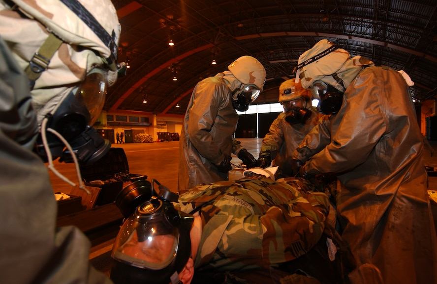 Staff Sgt. Nathan Leemen, 352nd Operation Support Squadron, medical element, is a convincing seizure patient to test the medical decontamination team for an IG inspection inject 26 Oct. 2005 during the ORI.