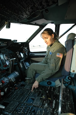 FLYING HIGH -- Staff Sgt. Susan Bolduc, 337th Airlift Squadron loadmaster, Westover Air Reserve Base, Mass., sits in her future workplace - the cockpit of a Patriot Wing C-5. Sergeant Bolduc recently learned she will attend Officer Training School. Once she earns her commission, she plans on pursuing her lifelong dream of being a C-5 pilot. (U.S. Air Force photo by Senior Master Sgt. Sandi Michon)