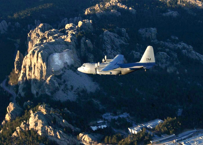 OVER SOUTH DAKOTA (AFPN) -- An EC-130H Compass Call aircraft flies over the Rocky Mountains during a training mission. The aircraft is from the 55th Electronic Combat Group at Davis-Monthan Air Force Base, Ariz. (U.S. Air Force photo by Airman 1st Class Christina D. Ponte)