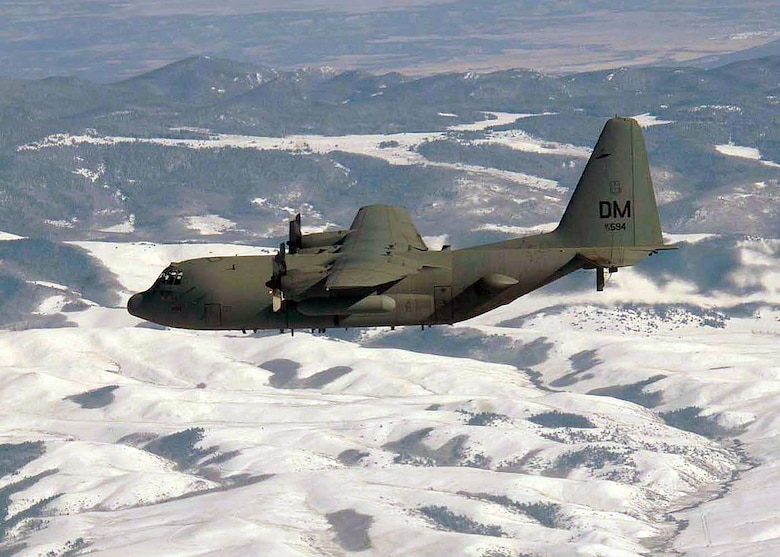 OVER COLORADO (AFPN) -- An EC-130H Compass Call aircraft flies over snow-covers hills during a training mission. The aircraft is from the 55th Electronic Combat Group at Davis-Monthan Air Force Base, Ariz. (U.S. Air Force photo by Airman 1st Class Christina D. Ponte)