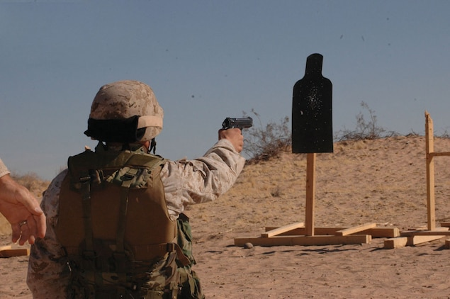 Master Sgt. Shawn Stevens, Marine Air Control Squadron 1 radar technician and native of Sequin, Wash., fires at a target with an M-9 pistol during the enhanced markmanship program range on the Barry M. Goldwater Range located southeast of the air station Nov. 17. Drills included firing with one hand in case the other hand was incapacitated.