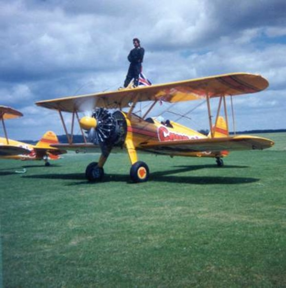 ENGLAND (AFMCNS) - Rick Penn, 66th Comptroller Squadron Financial Analysis Branch chief, prepares for take off atop a Stearman biplane, which he wing-walked in order to raise charitable funds. (Courtesy photo)