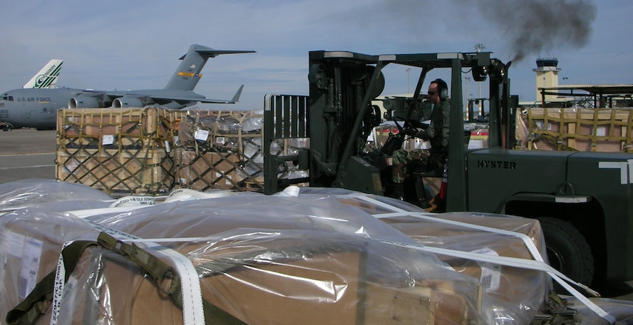 Technical Sgt. Paul Oxford, a reservist deployed from Travis AFB, Calif., moves another pallet of supplies a little closer to the warfighters in Iraq. Deployed through the holidays, the ramp services supervisor at Incirlik AB adds to the unit's total of about 86,800 tons of cargo sent down range since June 1.