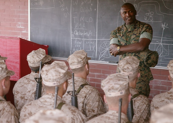 Sergeant Major of the Marine Corps John L. Estrada talks with recruits at Weapons and Field Training Battalion Oct. 19. Estrada also spoke with Marines at the Depot Theater about important issues affecting them today.