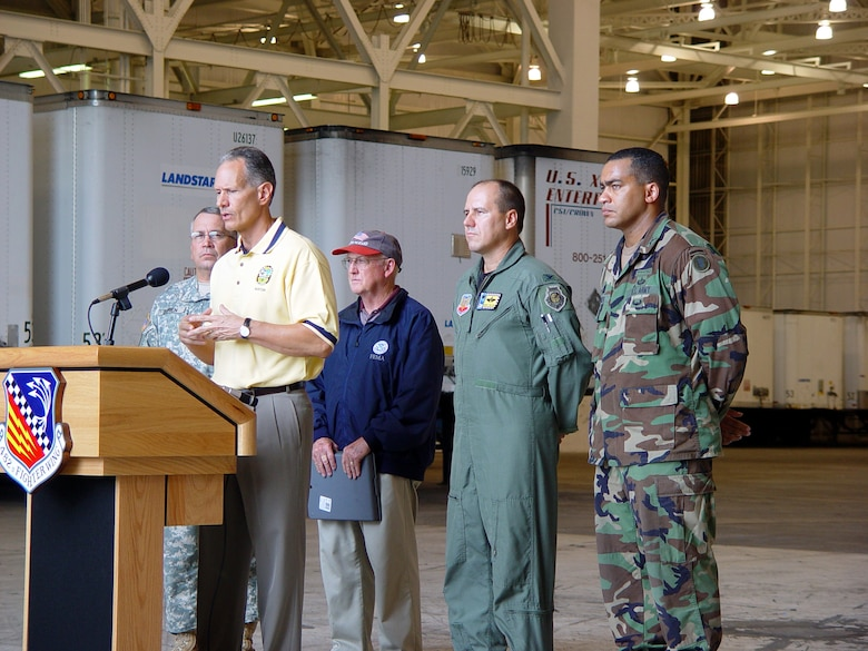 Officials host a joint press conference at Homestead Air Reserve Base, Fla. to inform local citizens about preparations for Hurricane Wilma.  The Federal Emergency Management Agency has partnered with Homestead Air Reserve Base to set up a relief staging area that will be used post-strike if necessary.  Picutred right to left:  Army Maj. Angel Mesa, 87th Brigade, Patrick AFB, Fla., Col. Randy Falcon, commander, 482d Fighter Wing, Homestead ARB, Fla., Mr. Frank Huff, FEMA's site coordinator at Homestead ARB, Fla., and Army Col. Joseph Duren, commander of the 50th Area Support Group, Florida Army National Guard.  Speaking at the podium is the Mayor of Miami-Dade County, Carlos Alvarez.