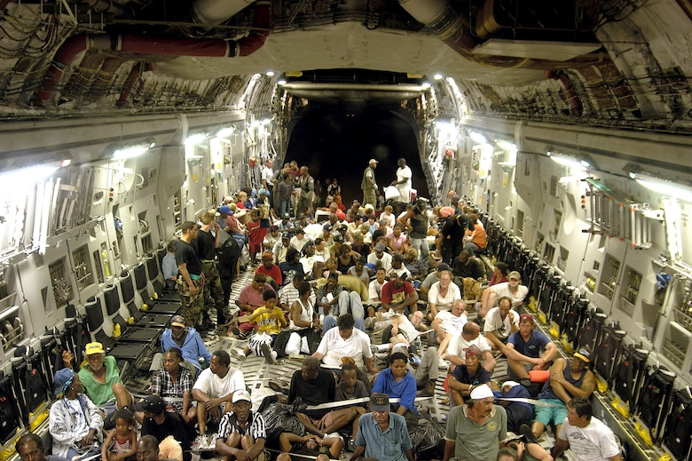 ONBOARD A C-17 GLOBEMASTER III -- More than 140 evacuees from New Orleans, victims of flooding caused by Hurricane Katrina, flew to Austin, Texas.  There, they were given food, fresh water and a place to sleep.  (U.S. Air Force photo by 1st Lt. Neil Senkowski)