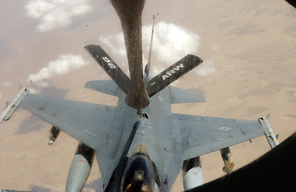 OVER IRAQ -- An F-16 Fighting Falcon moves into place behind a KC-135 Stratotanker.  The KC-135 is from the 92nd Air Refueling Wing at Fairchild Air Force Base, Wash., and the crew flying it is from McConnell AFB, Kan.  Thirty-five aircraft are refueled on an average day by coalition aircraft.  (U.S. Air Force photo by Staff Sgt. Justin Jacobs)