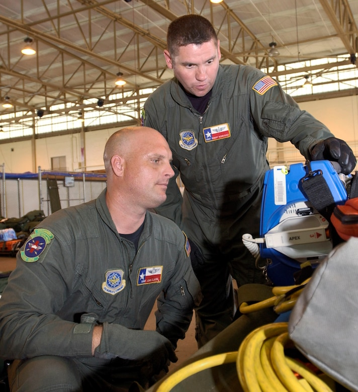 SAN ANTONIO -- Master Sgts. John Clauss (left) and Rob Rodriguez perform an operational check-up on a defibrillator. The two flying medics helped aeromedical evacuation teams organize and load their equipment for flights. They are with the 433rd Airlift Wing at nearby Lackland Air Force Base. (U.S. Air Force photo by Tech. Sgt. Jason Tudor)