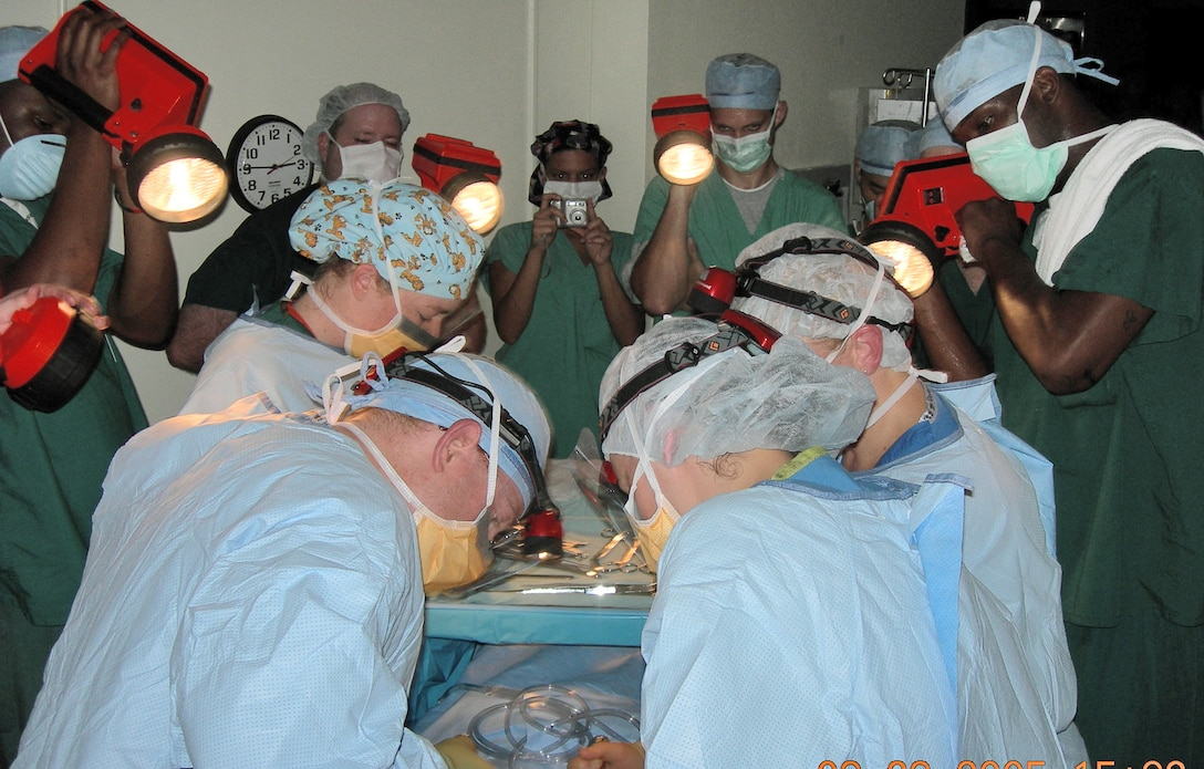 KEESLER AIR FORCE BASE, Miss. -- Industrial flashlights were used to illuminate the surgical field for a baby's delivery by C-section just after the peak of Hurricane Katrina had passed.  (U.S. Air Force photo by Maj. Betsy Majma)