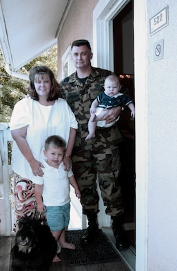 SMYRNA, Ga. -- Senior Master Sgt. David Hufton, his wife, Robin, their two sons, Dawson, 2, and Iain, 5 months, and their dog, Angus, live at a hotel here close to Dobbins Air Reserve Base.  Sergeant Hufton is an intelligence analyst with the 403rd Wing at Keesler Air Force Base, Miss., and had only been in his house in Ocean Springs, Miss., less than a month when it was destroyed by Hurricane Katrina.  (U.S. Air Force photo by Bo Joyner)