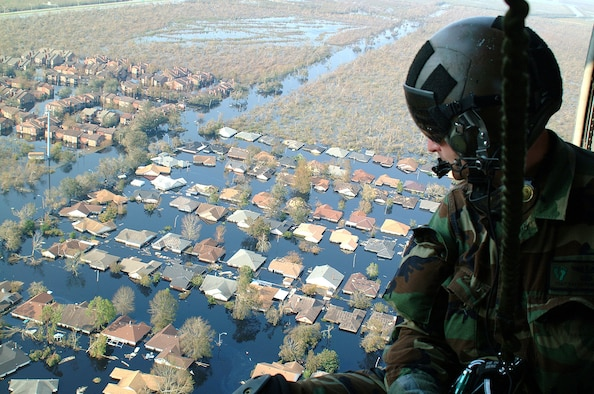 OVER NEW ORLEANS -- Tech. Sgt. Keith Berry looks down into flooded streets searching for survivors.  He is part of an Air Force Reserve team credited with saving more than 1,040 people in the aftermath of Hurricane Katrina.  He is a pararescueman with the 304th Rescue Squadron from Portland, Ore.  (U.S. Air Force photo by Master Sgt. Bill Huntington)