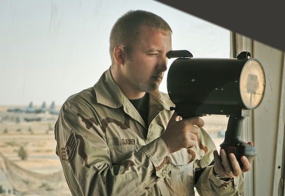 ALI BASE, Iraq -- Staff Sgt. John Gladney tests a light gun used to control aircraft if radio communication fails. Sergeant Gladney is an air traffic tower watch supervisor with the 407th Expeditionary Operations Support Squadron and is deployed from Tyndall Air Force Base, Fla. (U.S. Air Force photo by Master Sgt. Maurice Hessel)