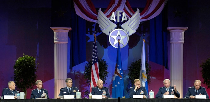 """WASHINGTON -- Gen. William R. Looney (second from right), commander of Air Education and Training Command, talks about the effects of hurricane Katrina on Keesler Air Force Base, Miss., during a four star forum moderated by Air Force Chief of Staff Gen. T. Michael Moseley on the second day of the Air Force Association's 2005 Air and Space Conference and Technology Exposition Sept. 13 in Washington, D.C.  The panel consisted of (from left) Gen. Bruce Carlson, AFMC; Gen. Robert H. """"Doc"""" Foglesong, USAFE; Gen. Paul V. Hester, PACAF; General Moseley, Gen. Ronald E. Keys, ACC; General Looney; and Gen. Lance W. Lord, AFSPC.  (U.S. Air Force photo by Master Sgt. Jim Varhegyi)"""