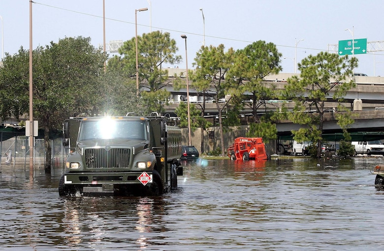 NEW ORLEANS -- An R-11 jet fuel truck drives through the flooded streets here to its operating location.  A fuels team from Barksdale Air Force Base, La., deployed here to assist with refueling operations in the city, to include refueling generators and stranded vehicles.  (U.S. Air Force photo)