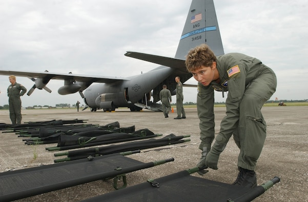 SEBRING AIRPORT, Fla. -- Senior Airman Amanda Sugg sets up cots here that were used in a C-130 to transport more than a dozen elderly Hurricane Rita evacuees back to Key West, Fla. Airman Sugg is an aeromedical technician attached to the North Carolina Air National Guard's 156th Aeromedical Squadron. (U.S. Air Force photo by Tech. Sgt. Brian E. Christiansen)