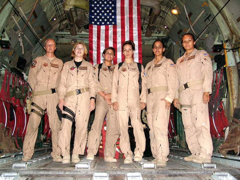 SOUTHWEST ASIA -- From left to right, Staff Sgt. Josie E. Harshe, flight engineer; Capt. Anita T. Mack, navigator; 1st Lt. Siobhan Couturier, pilot; Capt. Carol J. Mitchell, aircraft commander; and loadmasters Tech. Sgt. Sigrid M. Carrero-Perez and Senior Airman Ci Ci Alonzo, pause in the cargo bay of their C-130 for a group photo following a recent combat mission. (U.S. Air Force photo by Master Sgt. Alfred A. Gerloff Jr.)