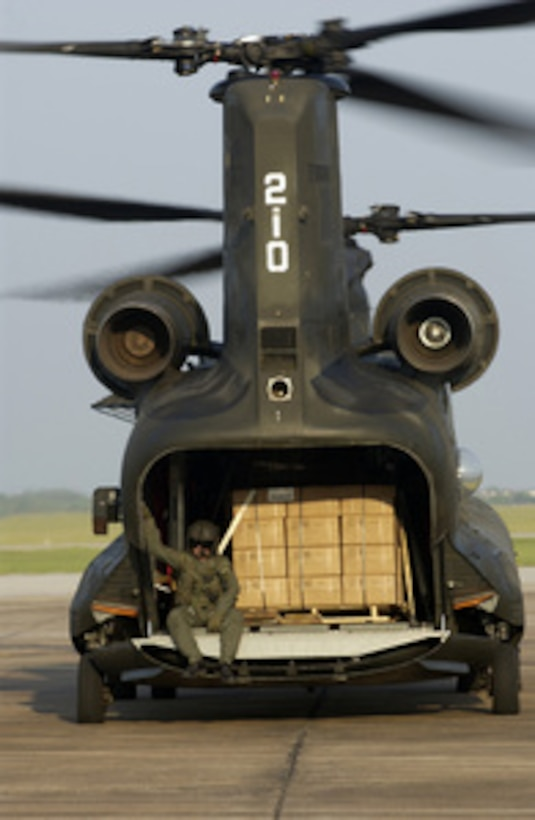 A U.S. Army CH-47 Chinook helicopter loaded with pallets of meals, ready to eat, prepares to take off at Ellington Field, Texas, in support of Hurricane Rita relief operations on Sept. 25, 2005. Department of Defense units are mobilized as part of Joint Task Force Rita to support the Federal Emergency Management Agency's disaster-relief efforts in the Gulf Coast areas devastated by Hurricane Rita.