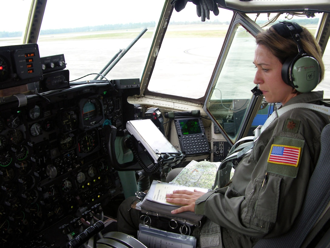 DUKE FIELD, Fla. -- Maj. Cathy Miller, co-pilot and aircraft commander for an aerial spray flight over Louisiana, goes through her preflight checklist shortly before takeoff. Air Force Reserve Command crews unanimously agree that the Gulf Coast missions are their most difficult aerial spray flights to date. (U.S. Air Force photo by Tech. Sgt. Shawn David McCowan)