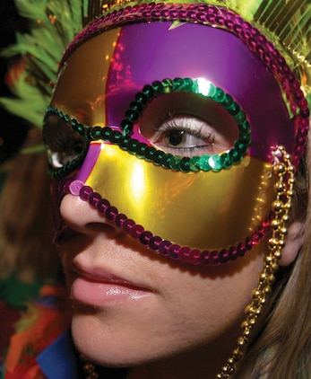 A mysteriously masked woman enjoys music from the Yuma Jazz Company in the Infinities enlisted club here Sept. 30 during the Marine Corps Community Services annual Mardi Gras party. The event, which raised money for active duty and retired service members and their families displaced by Hurricane Katrina, began in Infinites and later spread through the rest of the club.