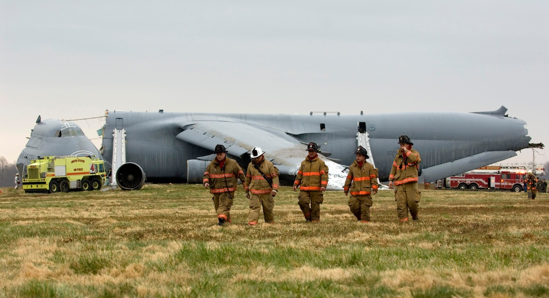 Emergency responders are on the scene of a C-5 Galaxy crash today, April 3, 2006 at Dover Air Force Base, Del. (U.S. Air Force photo/Doug Curran)