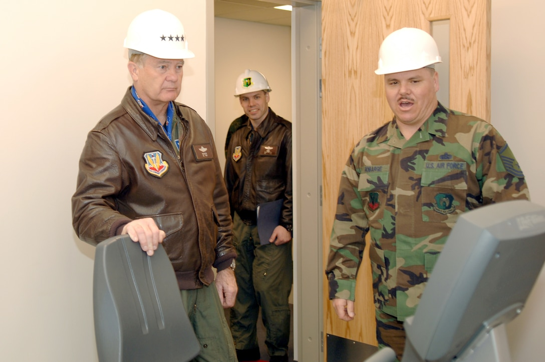Gen. Ronald Keys, Air Combat Command commander, receives a tour of the McAdoo Sports Center from Master Sgt. Robert Robarge, 5th Services Squadron superintendent March 28. General Keys was accompanied by Chief Master Sgt. David Popp, ACC command chief master sergeant, during his visit to the base.
