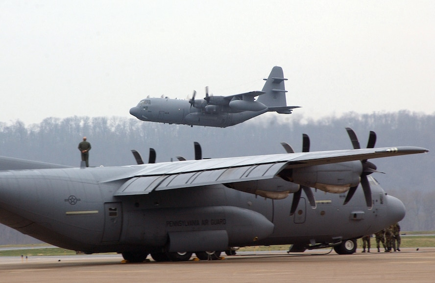 """The last Air National Guard's EC-130E Commando Solo takes off above a C-130 Hercules for the final time at the Harrisburg International Airport on Monday, April 3, 2006.  The """"E"""" model has flown members of the 193rd Special Operations Wing into combat since the Vietnam Conflict. (U.S. Air Force photo/Staff Sgt. Matt Schwartz)"""